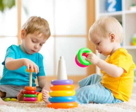Two children playing stacks