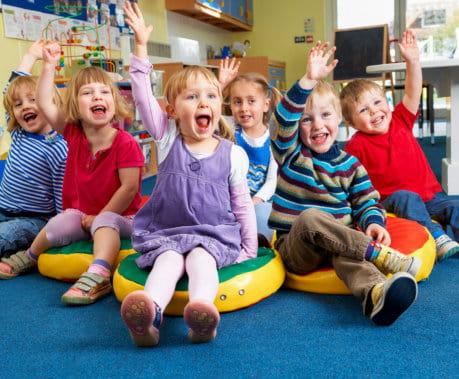 Children raising hands