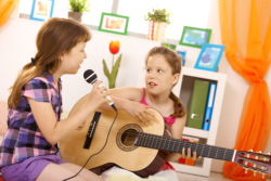 Girls are singing and playing guitar