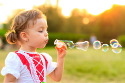 Girl is blowing bubbles